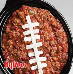 No fumbles here. Make Spicy Red Zone Chili for your crew. Don't skip drawing those sour cream laces either. It's easier than you think - just fill a resealable plastic bag with sour cream, snip the corner, and pipe on those laces.