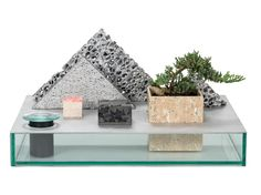 While poking around the website for the New York gallery Chamber this week, we stumbled upon on of our favorite things ever designed by Chen Chen & Kai Williams — a re-imagination of a traditional Japanese garden tray, that substitutes industrial metal products like aluminum foam and resin-treated travertine for the bonsai trees and natural stones typically used in such products.