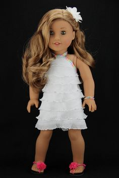 This listing is for a four piece outfit. It includes the dress, hair flower, bracelet and sandals. The dress is made with white ruffled knit