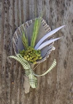 boutonnieres from my wedding, but replaced feathers with fresh lavender.