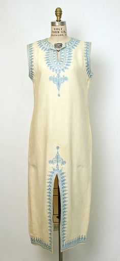 Dress    Date:      1960s  Culture:      African  Medium:      cotton, silk floss  Dimensions:      Length at CB: 50 1/4 in. (127.6 cm)  Credit Line:      Gift of Marvin B. Patterson (Mrs. Jefferson Patterson), 1978  Accession Number:      1978.582.201