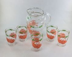 Orange Juice Pitcher Set with 5 Juice Glasses  Clear glass with oranges and leaves on pitcher and glasses.  Pitcher has pour spout stands 7 1/2 inches in height 6 3/4 inches in width. Holds 40 Ounces (5 cups).  Glasses are 3 1/2 inches in height and holds about 8 ounces (1 cup).  No chips or cracks.  Brand unknown.