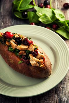 A no-fuss recipe for sweet potatoes stuffed with chicken breast, fresh spinach, and tart cranberries.