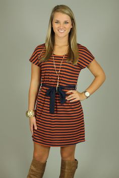 This dress is the epitome of Gameday! We wish you could feel this dress. Thanks to the soft material and easy fit, you will want to wear it a million times! The sash around the waist, makes into an adorable bow helping to give the illusion of a smaller waistline:) The best thing about this dress is....it's bra friendly!!!  Fits...