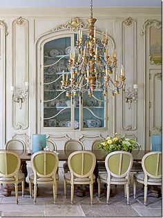 Beautiful French dining room with chandelier and stunning wood panelling...