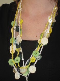 Green, yellow, white buttons with yellow and white embroidery floss