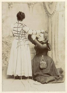 1890s seamstress taking very detailed measurements