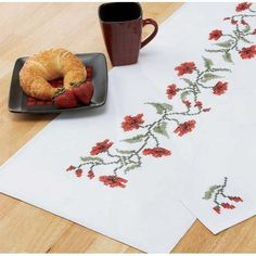 "Poppies on White Table Runner by Stitch Art. $14.99. Exclusive! Winding greens and pleasant poppies are a joy to stitch. Stamped for cross-stitch on white easy-care polyester/cotton fabric with a finished edge. Includes complete instructions. Approximately 14 x 44"" (36 x 112cm). Imported from Europe.Thread kit sold separately."