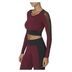 Garnet Crop Top MICHI NYC Burgundy color fitted, long sleeve crop top with black mesh paneling. Made by soft, eight-way stretch, moisture wicking, breathable, high performance fabric The Box Boutique | This Must Be The Pace | E-commerce | Sportswear | Shop Now | Free Uk Delivery | International Shipping | WWW.theboxboutique.com