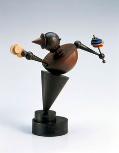 "Eberhard Schrammen, Maskottchen (Mascot). c. 1924, Oak and miscellaneous exotic woods, turned, coated in places with colored and gold lacquer, Height: 14-9/16"", Bauhaus-Archiv Berlin, Photo: Gunter Lepkowski, © Estate Eberhard Schrammen."