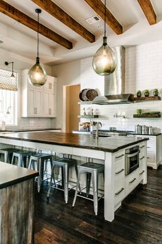 Kitchen - wooden beams, vintage metal stools, reclaimed wood counter, open shelving, subway tile