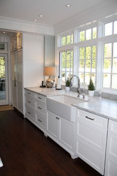 An undermounted apron sink - could be an interesting option ... Great use of space in kitchen! - eclectic - Kitchen - Charlotte - Hardwood Creations