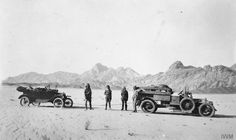 Captain T. E. (in uniform, second from the right) and his party during a mission to recover a crashed B.E.2c aircraft at Wadi Hamdh. Photograph taken near Jebel Raal, south east of Wejh, 6 May 1917.