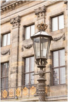 How to spend 48 hours in Amsterdam. Highlights from the Venice of the North. Unique lamppost at Dam Square. Travel tips for Amsterdam, Netherlands and Holland. © Degrees North Images #DamSquare