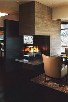 I love this kind of fireplace that can bring warmth to two rooms at the same time.