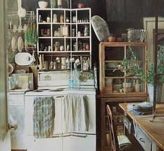 I absolutely love this old fashioned eclectic kitchen style!  I guess I'm just an old soul inside. ;)