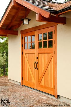 Custom Classic Carriage Doors complement this lovely home. Exterior Barn Doors, Garage Exterior, Diy Garage Door, Garage Door Design, Shop Doors, House Doors, Small Basement Apartments, Carriage Doors, Garage Remodel