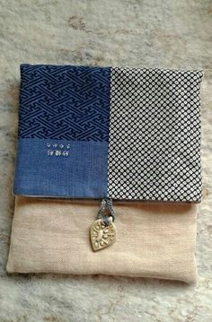 SOLD.   Foldover Pouch of soft Japanese cotton with ceramic button closure.