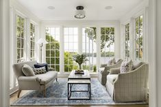 Custom builders John Kraemer & Sons built this lakeside coastal-inspired home that oozes luxury, comfort, and elegance. Country House Interior, Home Interior Design, Interior Ideas, Palladian Window, Floor To Ceiling Windows, Living Room With Fireplace, French Doors, Custom Homes, Colonial