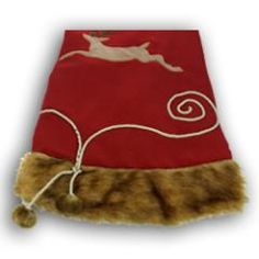 Red Reindeer with Mink Fur tree skirt at the Santa Claus Christmas Store.