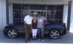 Archie & Becky Randolph are enjoying a few days on the coast visiting Archie's brother, our own Kevin Randolph. Then they will look cool and have a nice drive back to St. Joseph, Missouri, because they are now the new owners of this brand new 2014 Chevrolet Camaro! They bought it from Kevin and are pictured with him below. Butch Oustalet Chevrolet Cadillac- Pascagoula