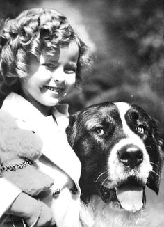 Shirley Temple with 'Buck', the 160 pound St. Bernard, 1935.