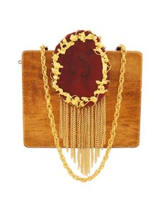 Mustard And Maroon Wood And Resin Waterfall Clutch   A high class mustard wood clutch from us is richly sketched and crafted in a plain mustard wood with high ended maroon oval-round shaped resin on the front top. The dropping chain danglers with exquisitely designed edges to the oval resin piece oozes the accessory. The group of golden flowers on the top for closure gives a true sparkling gleam to the accessory. Make it more trendy with the extra chained danglers given to attach them on…