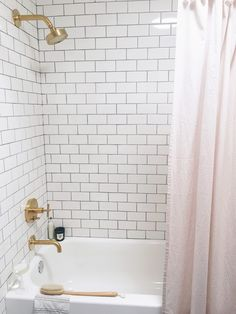 white subway tile and blush pink shower curtain