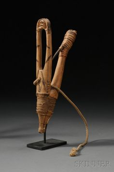 Northwest Coast Carved Wood Halibut Hook, c. with two upturned arms, the hands grasp a small skull, pyro-blacke. Small Skull, Tlingit, Carving Designs, Drift Wood, Halibut, Indigenous Art, Bone Carving, Outdoor Survival, Wood Carvings