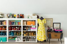 A dress Maggie is making currently and her shelves full of fabric and collected items.