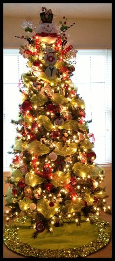 christmas trees decorated with mesh netting   Mesh, ribbon, and ornament-decorated Christmas tree.   Holidays