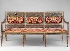 """Triple-back settee (part of a set), ca. 1790–1800, Italian, Sicily. Carved, gilded and painted walnut, reverse painted glass, cut and voided 17th-century crimson velvet. H. 38-3/4"""" (98.4 cm.); W. 78-3/8"""" (199 cm.); D. 26"""" (66 cm.) METMUSEUM"""