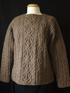 This pattern is one of the most popular of my career.  Celtic Dreams is an Aran pullover knitted from the top down, featuring saddle shoulders and square armholes, Aran motifs and a deep skirt (as the traditional Aran ribbing is called). The cuffs fit loosely in keeping with the early Arans. The saddle shoulders are worked first and the live stitches are put on holders. The front and back stitches are picked up along the edges of the saddles, and the neckline stitches are cast on. The front…