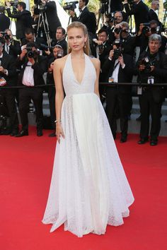 A Cannes Film Festival regular, the L'Oréal Paris ambassador wouldn't miss a year on the Croisette for the world. As she drops her suitcases at the Martinez and heads straight to the red carpet, we look back at Natasha Poly's best looks from 2008 to the today.