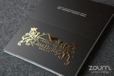 Fold-over business cards with embossed gold foil. Printed by www.zoum.ca.