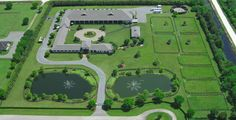 JUST FIVE ACRES!! ...on just 5 acres this horse farm has it all ... elegance, covered arena, stunning porte-cochere entry, immaculate stables, exquisite home, manager's apartment, grass turn out, round pen...