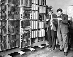 Peter Burden (left) and Frank Hawley, a master at the Wolverhampton college, in the 1960s checking a punched tape for the WITCH computer