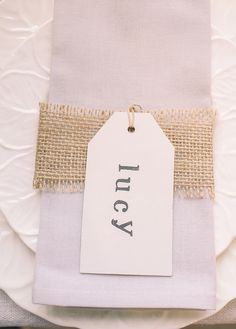 Simple name cards, stamp names onto luggage tags and tie hessian / burlap around the napkin.  All available from www.theweddingofmydreams.co.uk #wedding #diy #craft