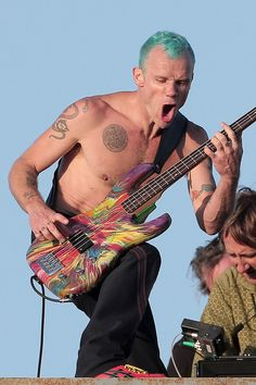 look at flea's bass! Jason would totally dig this. or...I would dig that Jason had this and he would be embarrassed by it. Whatever. Jason needs this.