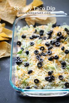 A lighter version of your favorite dip, this Skinny Taco Dip makes the appetizer for game day! This easy party dip can be made in a matter of minutes and is served cold. Healthy Appetizers Dips, Healthy Dip Recipes, Appetizer Dips, Skinny Recipes, Appetizer Recipes, Party Appetizers, Yummy Recipes, Mexican Dishes, Cinco De Mayo