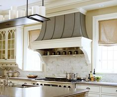 Like the windows on the sides of the cooktop.  Going to do the same concept in our house.  Light color scheme too