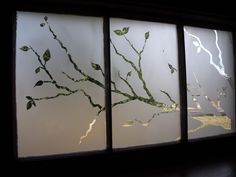 Frosted art on old window. Beautiful!