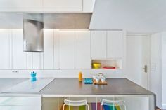 Colorful Apartment With A Multi-Functional Wall Unit - DigsDigs