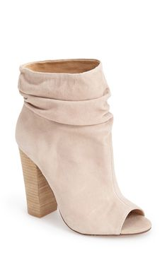 Can't get enough of these nude peep-toe booties. These stylish shoes go perfectly with every outfit, from everyday boyfriend jeans to a flowy summer dress.