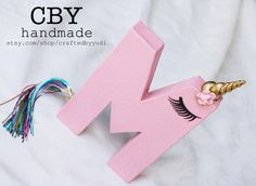 A personal favorite from my Etsy shop https://www.etsy.com/listing/504438336/unicorn-letter-or-number-monogram-pink