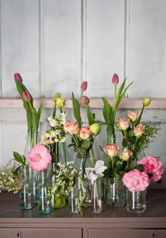 Gorgeous floral arrangement that works with a budget! Flowers in mismatched jars and bottles keeps it simple and stylish...and a great way to recycle!