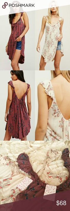 """LOT 2 Free People M Drifter Dresses in Ivry Purple TWO New With Tags Free People Drifter Dresses Woman's size Medium  -One in Purple -One in Ivry   Free People Drifter Tank Dress Color Code: Purple and Ivry Swingy tank in a lightweight ribbed fabrication with sweep ruffle detail along the neckline for a femme effect. Side vents and rounded hem make for an easy, effortless fit. 100% Viscose. Machine Wash Cold. New with tags. MSRP $98 each  Bust: 37.0""""  Length: 34.75"""" Free People Dresses"""