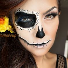This Day of the Dead Halloween-inspired look is to die for. Intricately painted details define this exotic yet fun makeup number. Take a peek at these must haves now.