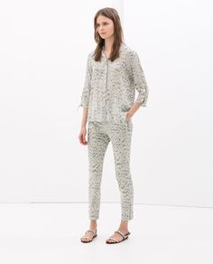Image 1 of PRINTED TROUSERS WITH ZIP HEM from Zara