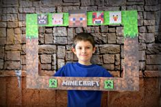 using foam board from the dollar store and free printable from pinterest I created my own minecraft frame for our photo booth.  also bought a back drop of bricks and sand.